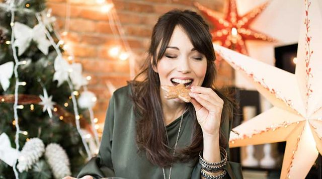 Woman snacks on a cookie