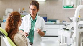 Woman talks with a dental specialist