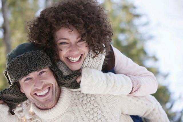 Enthusiastic couple piggybacking
